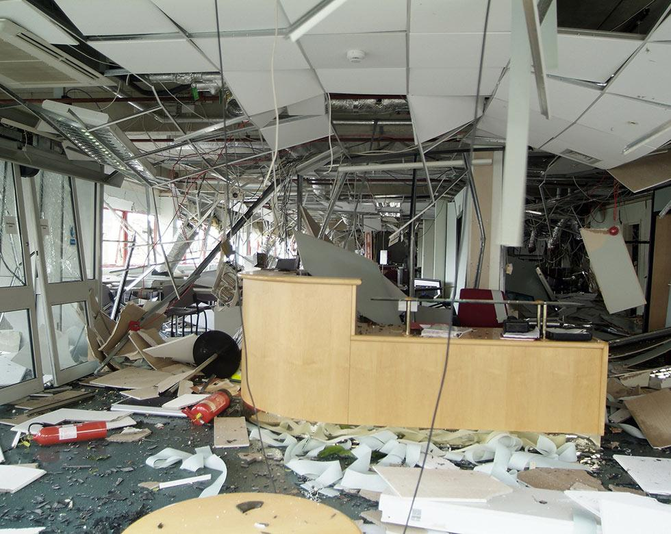 Commercial space destroyed by a storm with debris