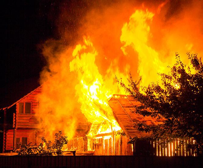House engulfed in flames needing Fire Damage Restoration in Roswell, GA